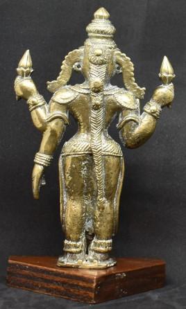 Lakshmi standing back