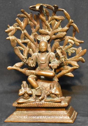 Dakshinamurthy under a tree